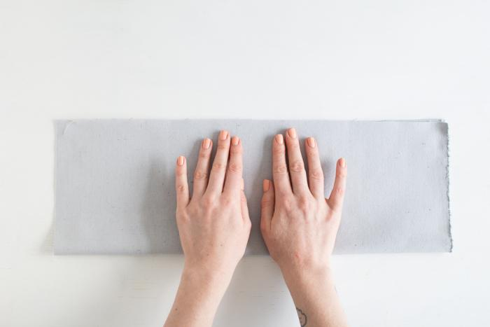 Сложите ткань