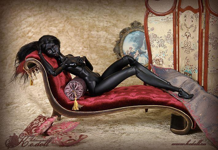 Черная кукла